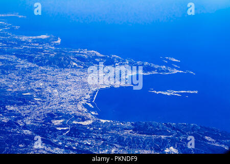 Blue planet earth aerial panorama. high altitude view of Marseille city, South France,  seen from an airplane cabin window on flight to mediterranean - Stock Photo