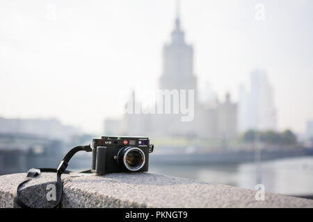 Leica M9 camera with Carl Zeiss Sonnar lens. On the background Radisson Royal Hotel. Moscow, Russia. October 11, 2014 - Stock Photo