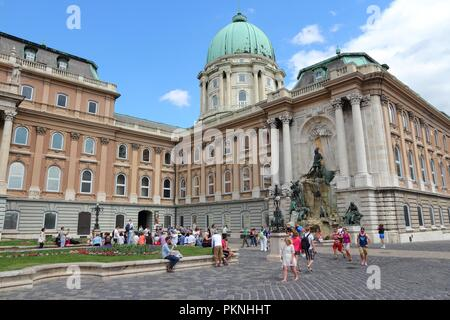 BUDAPEST, HUNGARY - JUNE 20, 2014: People visit Buda Castle in Budapest. It is the largest city in Hungary and 9th largest in the EU (3.3 million peop - Stock Photo