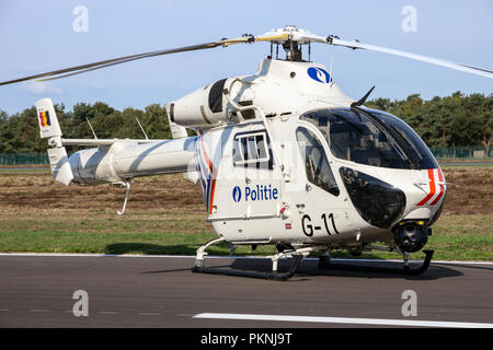 KLEINE BROGEL, BELGIUM - SEP 8, 2018: MD 902 Explorer helicopter from the Belgian Federal Police on the tarmac of Kleine-Brogel Airbase. - Stock Photo