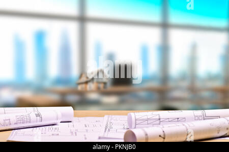 Architectural office with blueprints and an architectural model on a desk in the background - Stock Photo