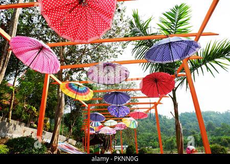 hanging umbrella in the park - Stock Photo