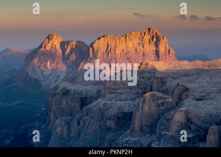Sunrise on the Sassolungo and Sella groups. The Dolomites. - Stock Photo