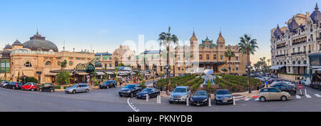 Panoramic view of Place du Casino in Monte Carlo Monaco with Grand Casino and Hotel de Paris with the mirror fountain out front - Stock Photo