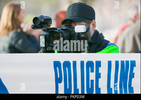 Police photographer photographing protestors at a climate change rally in London December 2008 - Stock Photo