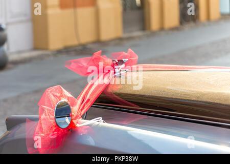 LUGO, ITALY - September 11, 2018: light enlightening  BENTLEY AND ROLLS ROYCE logoS on a car bodIES - Stock Photo