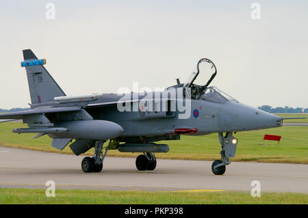 RAF Sepecat Jaguar jet fighter plane. Royal Air Force BAC Jaguar GR3 strike attack bomber aircraft taxiing in at RAF Waddington - Stock Photo
