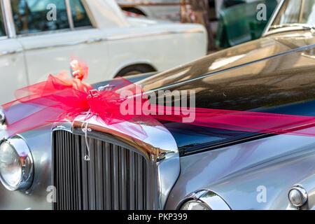 LUGO, ITALY - September 11, 2018: light enlightening BENTLEY logo on a car body - Stock Photo