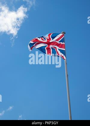 Union Jack Flag flying on a flag pole. - Stock Photo