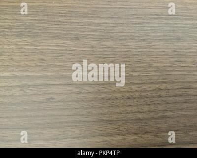 Closeup of polished wood surface showing wood grain. - Stock Photo