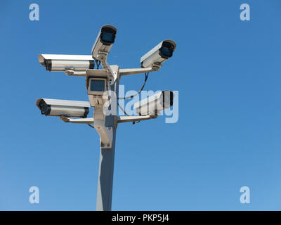 Image with various video surveillance cameras. Six cctv security cameras on the street pylon. Security cameras mounting on the high top position - Stock Photo