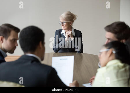 Woman passing job interview in the office at boardroom - Stock Photo