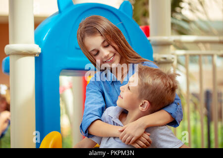 Closeup portrait of a cute siblings looking on each other with love, active summer holidays, brother and sister enjoying spending time together, happy - Stock Photo