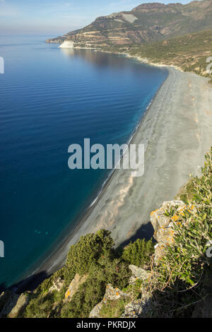 From above view of the beautiful sand beach of Nonza, Corsica, France. - Stock Photo