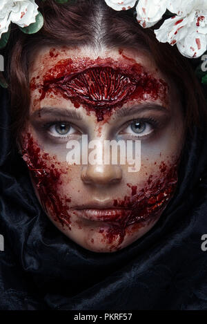 Portrait of bloody horrible scary zombie girl in a halloween festive makeup - Stock Photo