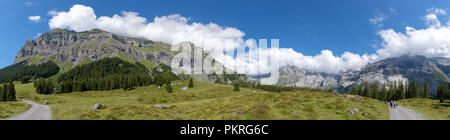 This panoramic view of the Swiss Alps in Kandersteg, Switzerland is both peaceful and stunning. A great place for hiking in nature! - Stock Photo