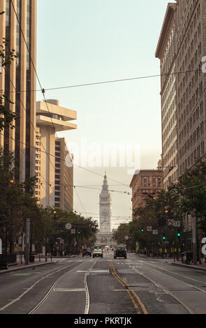 San Francisco Market Street at downtown, with the view of the Ferry Building, California, United States, on early Sunday morning. - Stock Photo