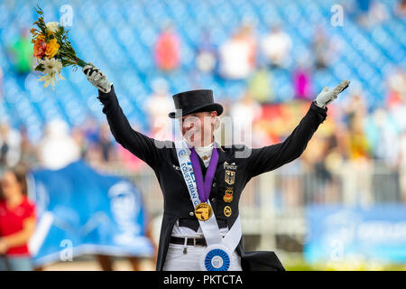 Tryon, USA. 14th Sep, 2018. Riding, FEI World Equestrian Game 2018, Grand Prix Special: Isabell Werth celebrates her victory on the podium. Credit: Stefan Lafrentz/dpa/Alamy Live News - Stock Photo
