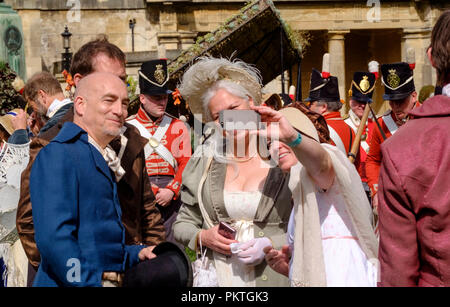 Bath, UK. 15th Sept 2018. Fans of the Jane Austen gather in regency dress to promenade through the historic city of Bath. The annual Jane Austen Festival draws people from all over the world to celebrate the famous novelists work. ©JMF News / alamy Live News - Stock Photo