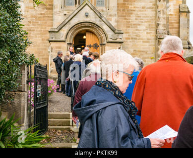 Gladsmuir Parish Church, Gladsmuir, East Lothian, Scotland, UK, 15th September 2018. The concert series continues on its second day with Bach's Musical Offering  by Dunedin Consort at the Lammermuir Festival in Gladsmuir. The 2018 Lammermuir Festival runs from 14th to 23rd September, and won the Royal Philharmonic Society Music Award in 2017. The Festival will celebrate its 10th anniversary in 2019. People queue to get into the concert and buy programmes - Stock Photo