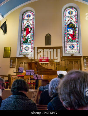 Gladsmuir Parish Church, Gladsmuir, East Lothian, Scotland, UK, 15th September 2018. The 2018 Lammermuir Festival won the Royal Philharmonic Society Music Award in 2017. The Festival will celebrate its 10th anniversary in 2019. The inside of the church with stained glass windows dedicated to Col James Ainslie who died 9th April 1876. Concert goers wait for a performance to begin - Stock Photo