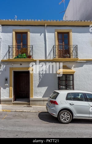 Spain, Ronda - 21 June 2017: CAR ON STREET BY BUILDING - Stock Photo