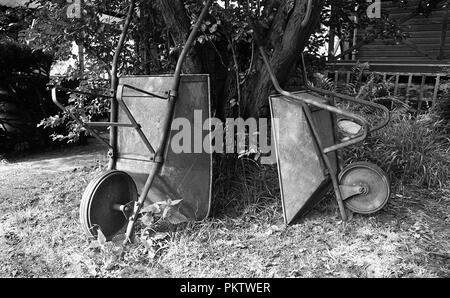 Old wheelbarrows in Garden, Black and white - Stock Photo