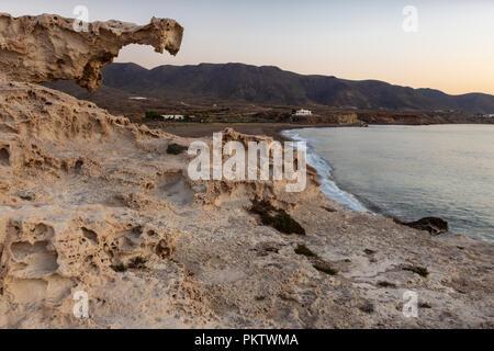 Natural arch. Landscape on the coast of Escullos. Natural Park of Cabo de Gata. Spain. - Stock Photo