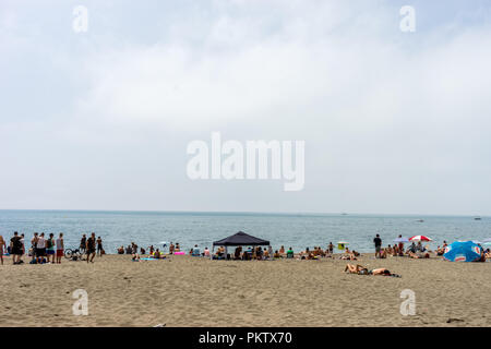 Malaga, Spain - June 24: The beach with huts at Malaga, Spain. This beach was part of the land reclaimed from the Malaga sea - Stock Photo