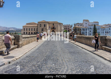 Spain, Ronda - 21 june 2017:  PEOPLE WALKING ON STREET AMIDST BUILDINGS IN CITY AGAINST SKY - Stock Photo