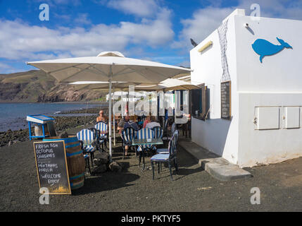 Seafood restaurant on the beach of the fishing village of Playa Quemada, Lanzarote, Canary Islands, Spain - Stock Photo