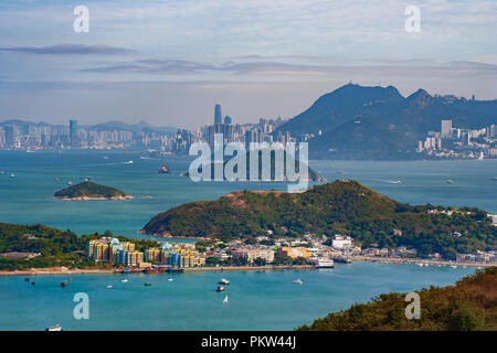 Hong Kong Skyline with small Island and Fisher Village in Foreground - Stock Photo