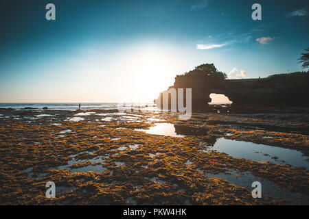 Bali Landscape beautiful of Tanah lot temple in the morning. - Stock Photo