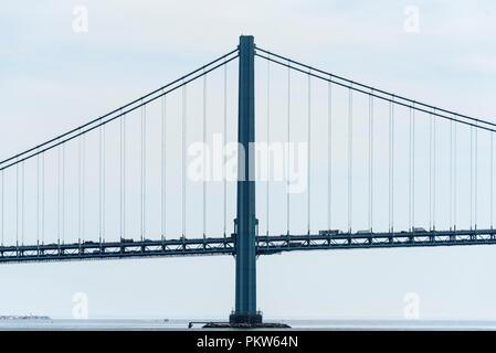 04-2018 New York, USA. Verrazano-Narrows Bridge over New York Harbor. Circa-1964 suspension bridge featuring 693-ft.-tall towers & linking Brooklyn & - Stock Photo