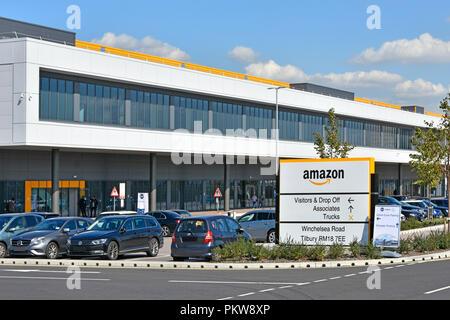 Big Amazon warehouse & distribution centre building handles online shopping retail internet & technology business development Tilbury Essex England UK - Stock Photo