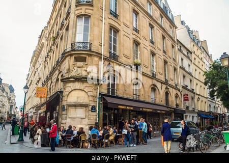 PARIS, FRANCE - JULY 11, 2014: Cafe Bar Restaurant of the city center of Paris, during the afternoon, with people drinking in front of it during a hap - Stock Photo