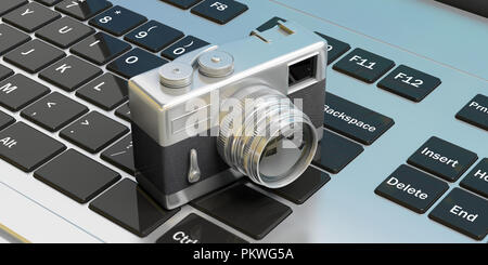 Vintage photography concept. Retro camera on computer keyboard, , 3d illustration. - Stock Photo