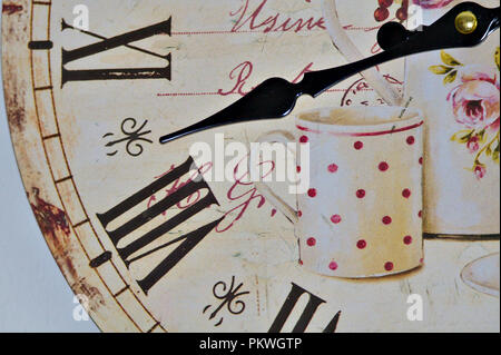 Wall clock illustrated with coffee cup. - Stock Photo