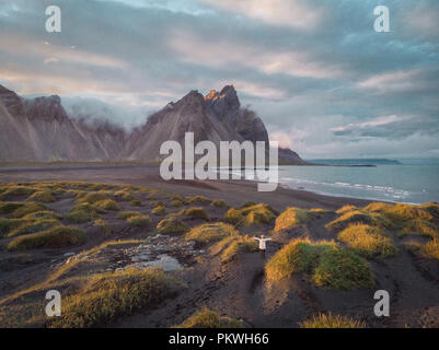 Black sand dunes on the Stokksnes headland on southeastern Icelandic coast with Vestrahorn (Batman Mountain). Colorful summer morning Iceland, Europe. Artistic style post processed photo. - Stock Photo