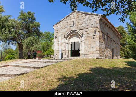 Guimaraes, Portugal - July 28, 2017: Romanesque Capela de Sao Miguel Chapel, near the Guimaraes Castle, where medieval knights are buried. - Stock Photo