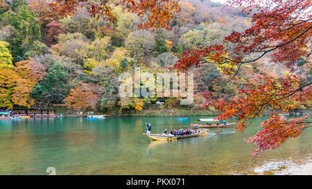 Kyoto, Japan - Nov 25, 2017: Arashiyama and Katsura river is the famous destination for tourist in autumn of japan. Many tourists sightseeing by japan - Stock Photo