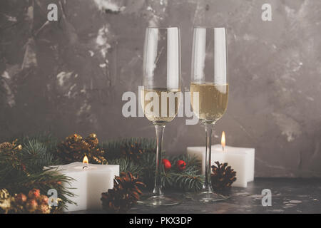 Christmas background with candles and glasses of champagne. Christmas card concept. - Stock Photo