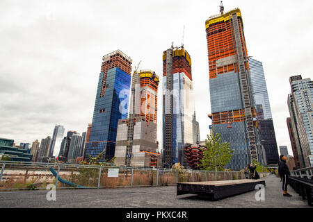 New York, USA, October 30, 2017: Hudson Yards train depot from the High Line. New York City skyline with urban skyscrapers in construction. View from  - Stock Photo