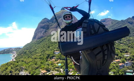 Paraglider pilot, physical handicapped, riding their own paragliding, pure adventure in Rio de Janeiro Brazil. Cultural diversity, handicapped man. - Stock Photo