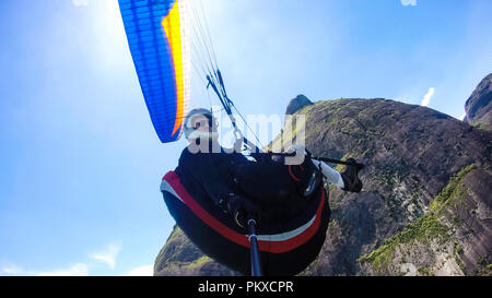 Cultural diversity, handicapped man. Paraglider pilot, physical handicapped, flying in their own paragliding. - Stock Photo