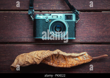Autumn concept. Autumn leaves and retro camera. Fall photo shoot concept - Stock Photo