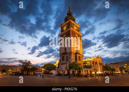 Krakow, Poland - August 23, 2018: The Town Hall Tower and the Cloth Hall in the main square of Krakow, Poland. - Stock Photo