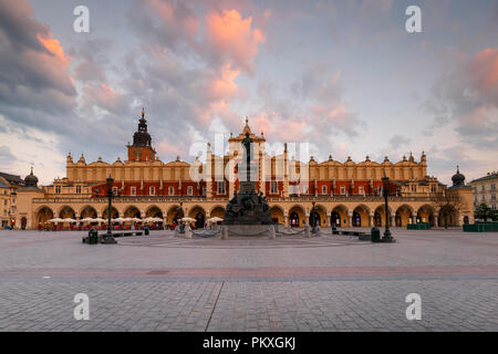 Krakow, Poland - August 23, 2018: The Cloth Hall and Town Hall Tower in the main square of Krakow, Poland. - Stock Photo