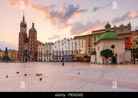Krakow, Poland - August 23, 2018: Church of St. Wojciech and St. Mary's basilica in the main square of Krakow, Poland. - Stock Photo