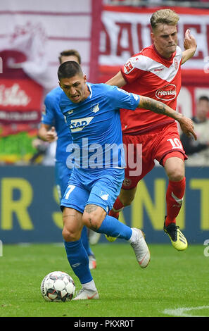 Duesseldorf, Germany. 15th Sep, 2018. Steven Zuber (front) of Hoffenheim competes during the Bundesliga match between Fortuna Duesseldorf and TSG 1899 Hoffenheim at Esprit-Arena in Duesseldorf, Germany, on Sept. 15, 2018. Duesseldorf won 2-1. Credit: Ulrich Hufnagel/Xinhua/Alamy Live News - Stock Photo
